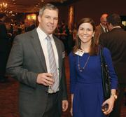 KFORCE Inc.'s A.J. Ray, left, and Alyssa Kunselman of Duane Morris Government Strategies mingle at the event.