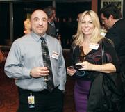 Michael Perella and Christine Tomasits of DQE Communications at the Business Times' event.