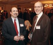 Steve Shivak, left, of SMC Business Councils networks with John Zahner of Zahner CPA.