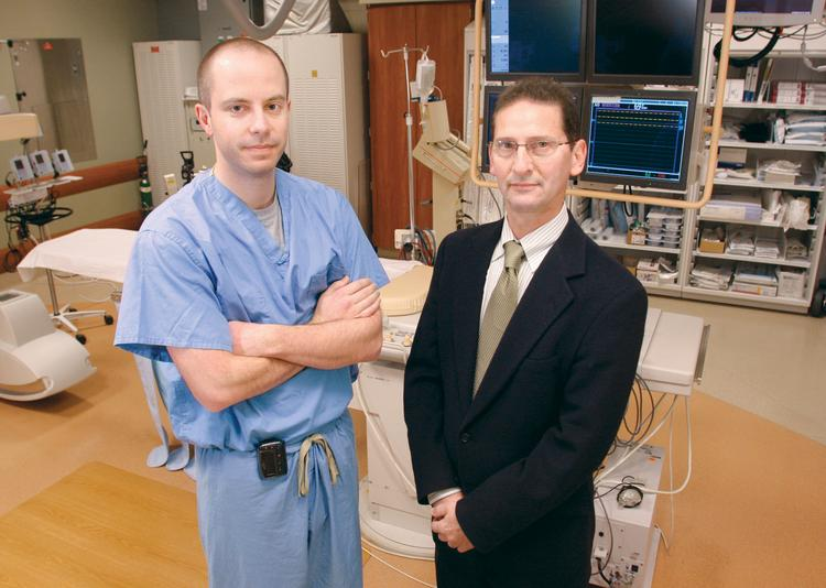 Cardiologists Dr. James Lynch, left, and Dr. Alan Olivenstein stand in a catherization lab at Excela Health Westmoreland Hospital in Greensburg.