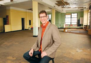 Alexander Denmarsh is the new owner of the Paramount building in Uptown. He plans to move his commercial photography studio into the building.