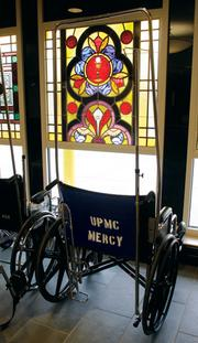 Stained glass windows dating from 1882, which were used in a UPMC Mercy chapel were incorporated into the design of the ER.