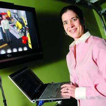 Etcetera Edutainment Inc. CEO Jessica Trybus with one of her company's simulation programs on the screen.