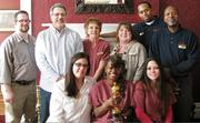 Desiree Staude, front left, Teika Williams and Shannon Hullihan, along with Tim McGlothlin, back left, Gene Lucente, Pat Yurko, Rebecca Lazeration, Devin Owens and Bill Jones, all members of the Priory Hotel staff, with the Oscar. The Oscar started its road trip in NYC on Feb. 4 and is trekking across America to arrive in Hollywood, Calif.
