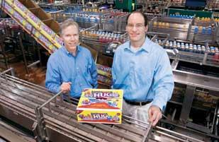 American Beverage Corp. President Kevin McGahren-Clemens, left, and Vice President of Operations Nate Rekich show off the company's Little Hugs fruit drinks line.