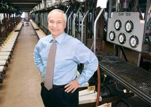 Wabtec President and CEO Albert Neupaver stands near a brake system test rack the company uses to simulate 250 rail cars.