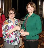 Tawnya Curatola, left, and Kim Niday, both with the Regional Learning Alliance, chat at the event.