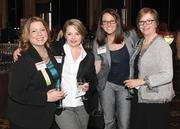 Jennifer Daurora, director of business development at McGinnis Sisters Special Food Stores, left, mingles with Allegheny College's Marjie Klein, Meghan Cressman and Melissa Mencotti at the BusinessWomen First Awards.