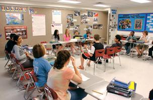 Fort Couch Middle School students in Jan Conn's eighth-grade social studies class use a classroom with a movable wall, which allows two teachers to conduct activity between two classes.