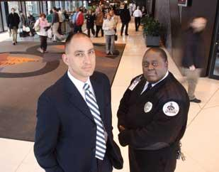 Black Knight Security President Dennis Lejeck, left, stands with shift supervisor George Gray. Lejeck started the company in Chicago before moving it to Pittsburgh.