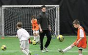 Jason Kutney, CEO of both the Pittsburgh Riverhounds and the Greentree SportsPlex, conducts drills during a Riverhounds Academy session held at the facility.