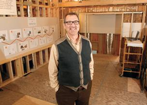 Regis McQuade, president of Master Remodelers, stands in his Mount Lebanon home, which was recently rebuilt after a fire and is now being used as a showcase to potential clients for his company.