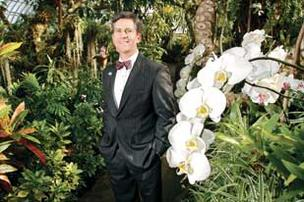 Will Knecht, president of Wendell August Forge, photographed in the Orchid Room at Phipps Conservatory and Botanical Gardens.
