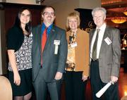 Diamond Award winner Mike Cherock of AE Works is flanked by his wife, Laura, his mother, Jean Dean, and his stepfather, Walt Dean, at the event.