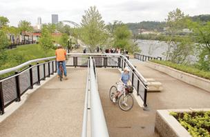 Joanne Winwood and her son Dan Winwood, both of Swissvale, navigate through a switchback May 2 at the South Shore Riverfront Park, located near SouthSide Works.