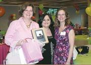 Satchels of Caring Foundation's Bags, Bellinis & Brunch event May 1 benefited women with cancer. Shown are Cindy Nielsen, left, the winner of the grand prize, with Connie Skezas and foundation President Heather Knuth.
