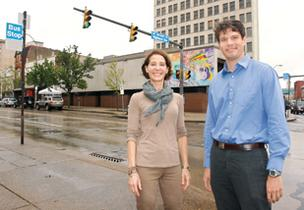 Molly Blasier with Blasier Urban LLC and Nate Cunningham of East Liberty Development Inc. stand at the intersection of Penn and Highland avenues in East Liberty.