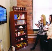 A Nintendo Wii and books are some of the items available to employees in a small relaxation lounge in the offices of Heartland Restaurant Group in the Strip District.