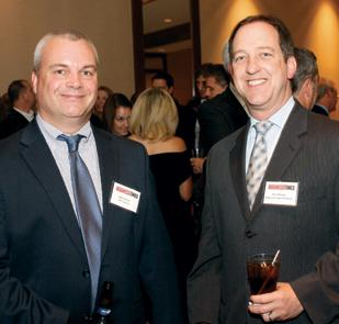Bill Zollars, BPL Global, left, chats with Jim Wilson, Duquesne Light Holdings, prior to the Energy Leadership Awards ceremony.