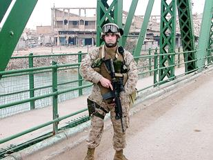 Justin Nickola, a water logistics manager at Range Resources, was on active duty in the Marines for seven years. Here, he is shown in Fallujah, Iraq, in 2005.