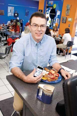 LoyalTree CEO Brock Bergman gets some food at Square Cafe in Regent Square. Square Cafe was an early user of the LoyalTree mobile app.