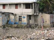 Ian Rosenbeger, founder and CEO of Thread LLC, surveys one of Port-au-Prince's hundreds of drainage and waste canals.
