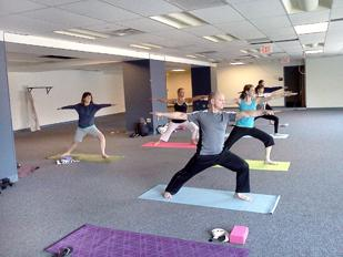 On-site yoga is among the programs MARC USA offers its employees through a customized wellness plan.