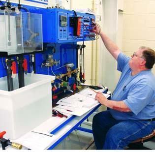 John Barnes, an electrical contractor from McMurray, works on instrumentation and controls in the mechatronics lab at the Community College of Allegheny County's West Hills campus in Oakdale.