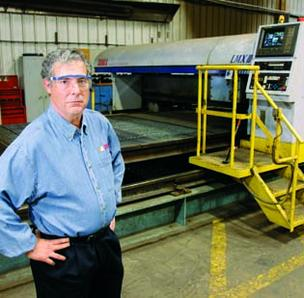 Scott Metals Inc. CEO Edward J. Cipriano nearly lost this Tanaka laser cutting machine to floodwater in 2004. A cooler on the machine was damaged, but rising water missed the electronic components by six inches.