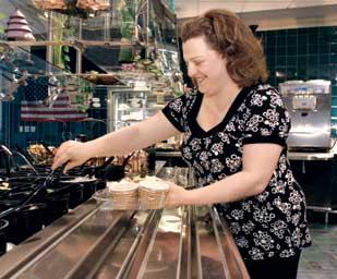 Kennametal senior buyer Amy DiBiase enjoys the offerings at the Kafe's salad bar.