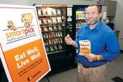 """John Bielinski, manager of global benefits, implemented SmartPick healthy options in the company's vending machines. """"I have always been active, but am now even more aware of what I am eating and doing to keep healthy,"""" he said."""
