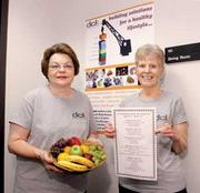 At dck worldwide LLC, Donna Moresea, left, is food service manager. Peggy Vollmer is a food service assistant.