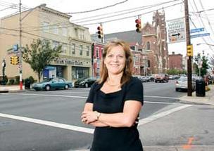 Karla Owens, executive director of the Bloomfield Development Corp.,  is exploring the option of establishing a neighborhood improvement district.