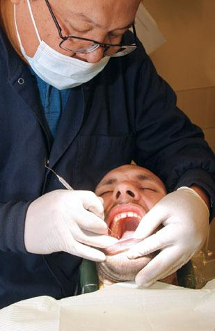 Dr. Lionel Carlos is the Free Health Care Center's first full-time dentist.