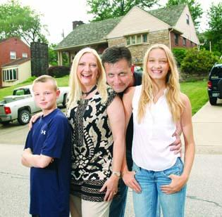 Leagha and Michael Courtney, with their son, Christian, 10, and daughter, Calista, 13, outside their Mt. Lebanon home. The Courtneys also have an 18-year-old son, Cameron, who will begin college this fall.