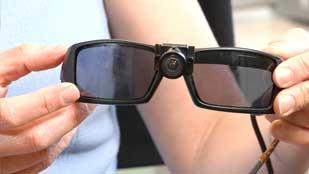 The BrainPort device consists of a pair of sunglasses with a camera  mounted in the bridge. An image is sent to a handheld box which converts it into electrical impulses that are sent to the electrodes on the tongue.
