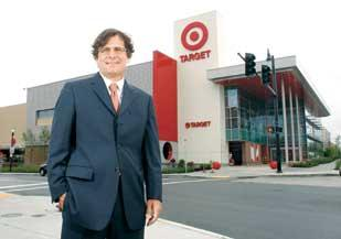 Steve Mosites, principal of Mosites Co., stands across the street from the new  Target at his company's Eastside Project in East Liberty.