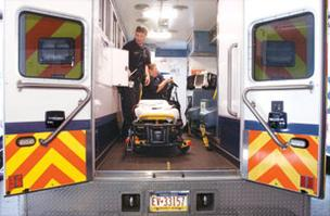 Rob Leuthold and Christine Anthony, paramedics with North Huntingdon EMS/Rescue, perform a routine morning vehicle check.