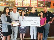 Pittsburgh-area Dunkin' Donuts presented Children's Hospital of Pittsburgh Foundation with a $2,500 donation on behalf of its customers on Wednesday, July 11. Pictured (left to right): Laura Swisher, Peter Ramage, Robyn Frederick, Ed Duss, Kristen Crusan and Jim Rogers.