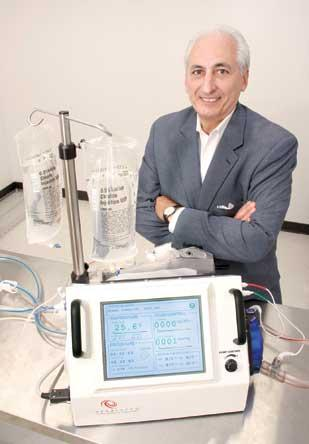 ThermalTherapeutic Systems President and CEO Raymond Vennare stands next to a Veratherm Portable Hypothermic Perfusion System unit.