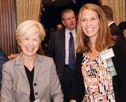 UPMC Health Plan's Susan Stocker, left, and Monica Lorish mingle at the VisionPittsburgh event.