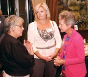 Sandra Olenick, left, and Sherri Klutch, center, both of MassMutual/Financial Designs, chat with Kim Tillotson Fleming of Hefren-Tillotson Inc. at the event.