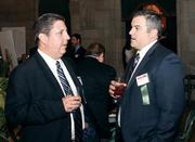 Jim Suhanin of Comcast Business Class, left, networks with Brian Curley of Luttner Financial Group at the event.