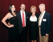 Michael Cherock, second from left, of AE Works, was joined by his wife, Laura, and his mother, Jean Dean, and his stepfather, Walt Dean, at the event.