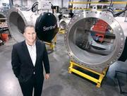 Calgon Carbon Corp. (NYSE: CCC) President/CEO Randy Dearth stands next to a 48-inch Sentinel Chevron reactor at the company's UV technologies division in Coraopolis. In an interview with the Pittsburgh Business Times, Dearth talks about his new gig running the company.
