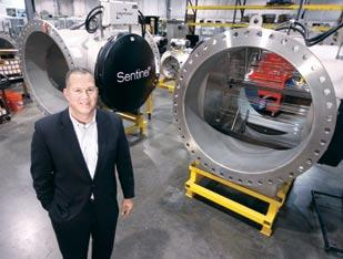 Calgon Carbon Corp. President and CEO Randy Dearth stands next to a 48-inch Sentinel Chevron reactor at the company's UV technologies division in Coraopolis.