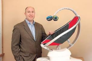 Rob Daley, CEO of 4moms, stands next to the bouncing baby seat mamaRoo, one of several products that have sold well this year.