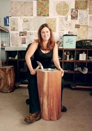 Mosaic artist Rachel Sager Lynch cuts stone in her Murrysville studio.