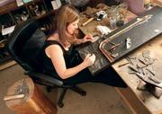 """Rachel Sager Lynch works on a commissioned """"Mighty Marcellus"""" art piece in her Murrysville studio."""