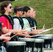 Drummers in Upper St. Clair High School's Marching Band rehearse during band camp.